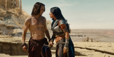 """JOHN CARTER"" L to R: John Carter (Taylor Kitsch), Dejah Thoris (Lynn Collins) ©Disney Enterprises, Inc. All Rights Reserved."